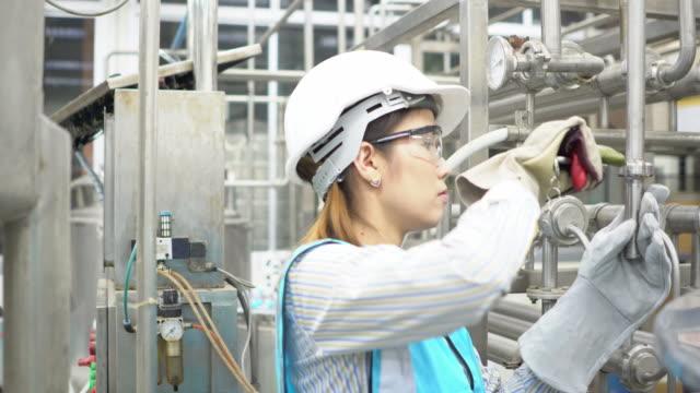 female engineer with helmet at work
