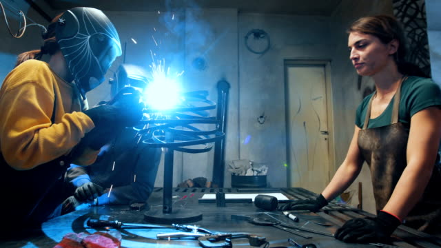 female engineer work with welding machine - welding stock videos & royalty-free footage