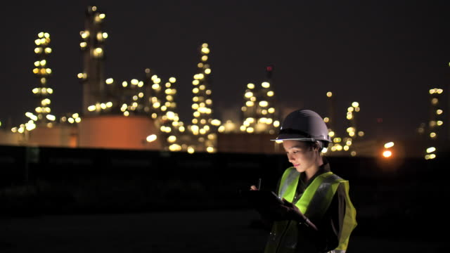 female engineer working at night - hardhat stock videos & royalty-free footage