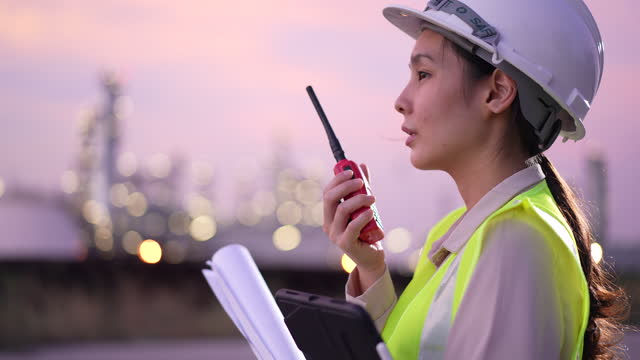female engineer working with walkie talkie in construction site - pipeline stock videos & royalty-free footage