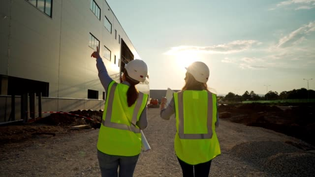 female engineers overseeing construction site - quality control stock videos & royalty-free footage