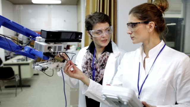 Female engineers working in research lab