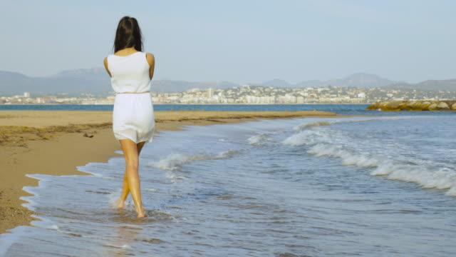female enjoying time on the beach.
