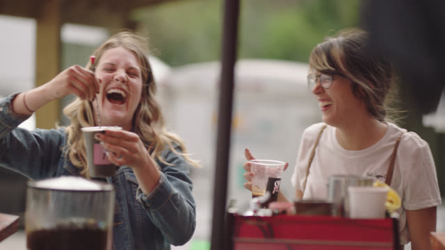 female entrepreneur makes an espresso while her business partner talks to customers - customer focused stock videos & royalty-free footage