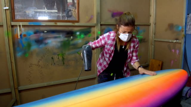female entrepreneur making custom surfboards - craftsperson stock videos & royalty-free footage