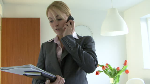 female estate agent talking on mobile phone, uk - females stock videos & royalty-free footage
