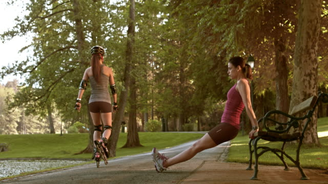 DS Female exercising on a park bench