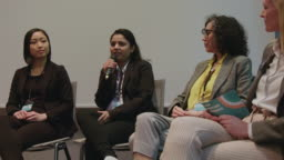 Female expert panel in convention center at hotel