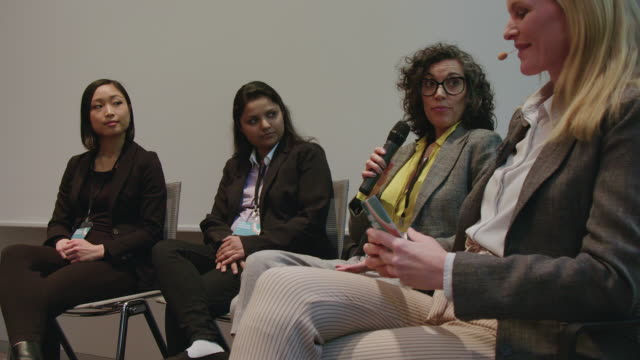 female expert panel in hotel during seminar - panel discussion stock videos & royalty-free footage