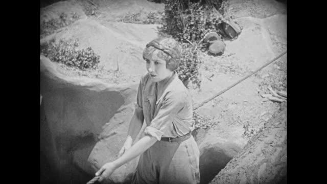 1925 Female explorer grows faint crossing makeshift tree bridge