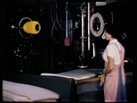 female factory worker moving foamex foam sheet on machine table for pressing rod. female workers putting foamex pillows into pillow cases in... - warehouse点の映像素材/bロール