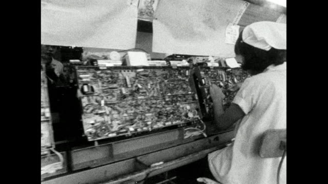female factory workers assemble television sets in japan; 1966 - bbc archive stock-videos und b-roll-filmmaterial