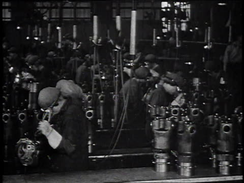 female factory workers / female worker removing goggles and smiling/ man presenting her with liberty bond / - manufacturing occupation stock videos & royalty-free footage