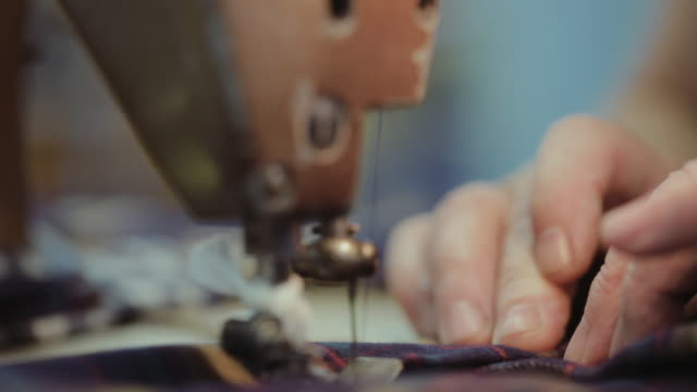 female factory workerís hands at sewing at table - cucire video stock e b–roll