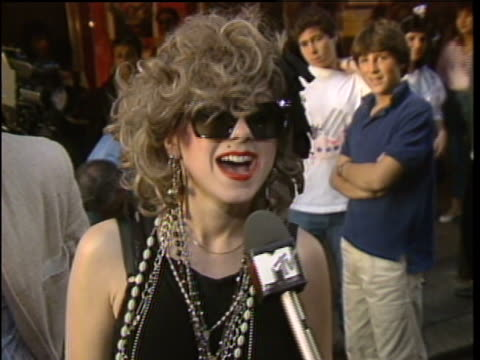vídeos de stock e filmes b-roll de female fan dressed like madonna talking about why she loves madonna. - 1985