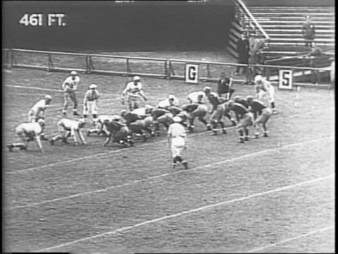 female fan jumping excitedly / michigan makes touchdown by arthur renner / crowd goes wild / army makes touchdown by glenn davis. - ウェストポイント点の映像素材/bロール