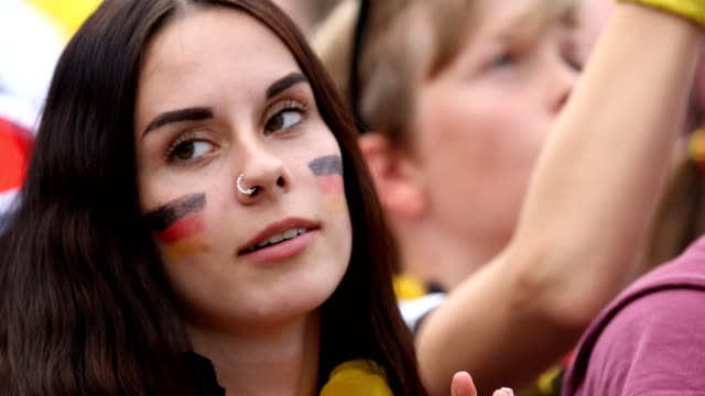 A female fan with the german flag colors on her cheeks is disappointed while Germany is loosing the 2018 FIFA World Cup Russia Group F match against...