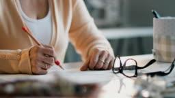 Female fashion designer sketching in her tailor studio