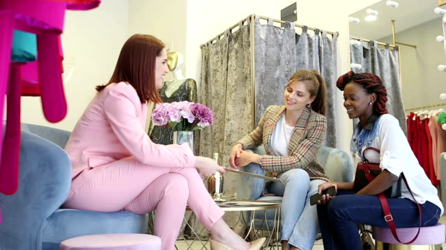 female fashion designer with customers  in fashion design studio - boutique stock videos and b-roll footage