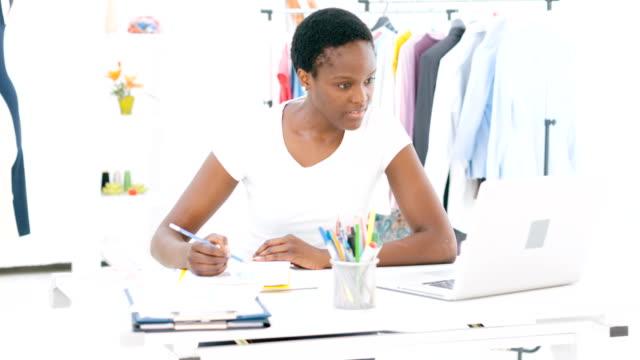 HD: Female Fashion Designer Working At Laptop.