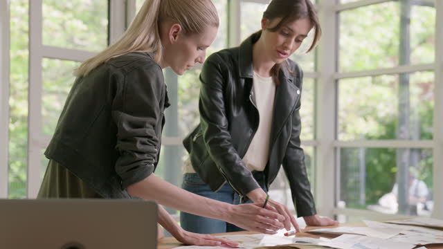 female fashion designers working together. creating new collection, picking projects - fashion collection stock videos & royalty-free footage