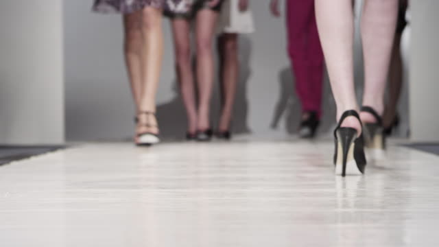 MS LA Female fashion models wearing high heels walking down and back on catwalk