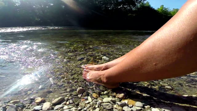 female feet in clear river - smooth stock videos & royalty-free footage