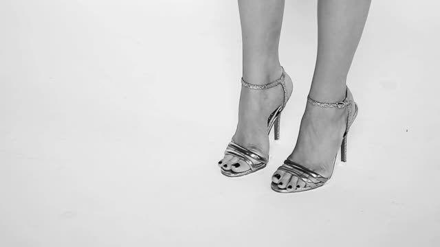 female feet in sexy high heels shoes. b&w - sandal stock videos and b-roll footage