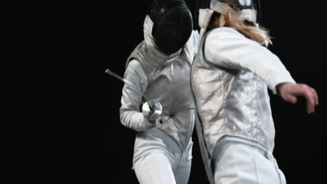 slo mo female fencer striking her opponent with the tip of the foil - rivalry stock videos & royalty-free footage
