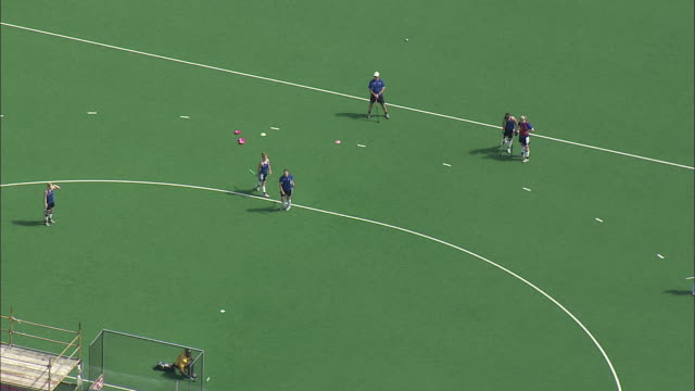 aerial female field hockey players practicing goal, cape town, western cape, south africa  - ホッケー点の映像素材/bロール