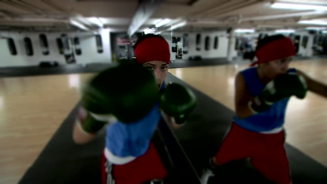 Female fighter shadowboxing