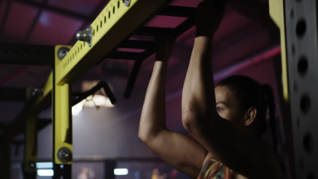 female fighter workout at dark gym. pull ups - hoisting stock videos & royalty-free footage