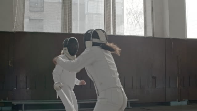 Female fighters fencing