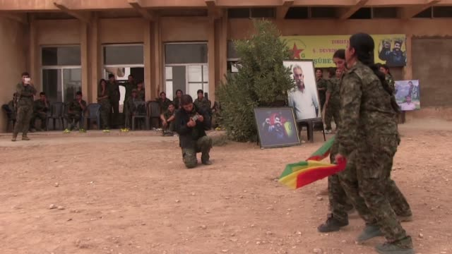 female fighters of the women's protection units ypj holding hands and performing a traditional kurdish dance in a training camp on october 12, 2014... - people's protection units stock videos & royalty-free footage