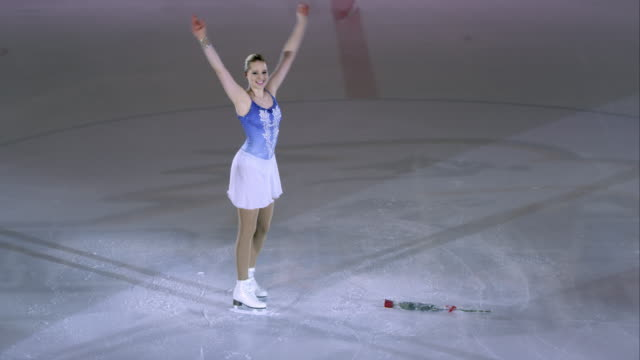 ts female figure skater bowing after performance - ice skating stock videos and b-roll footage