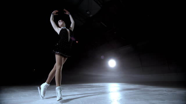 slo mo ds female figure skater holding an elegant pose - ice skating stock videos and b-roll footage