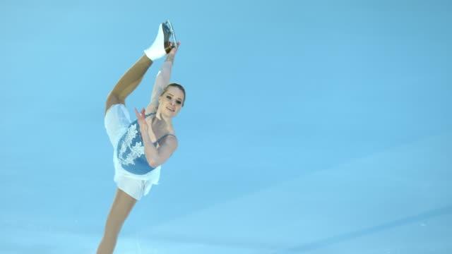 SLO MO TS Female figure skater holding figure while gliding