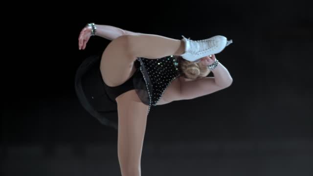 SLO MO TU Female figure skater in a catchfoot spin