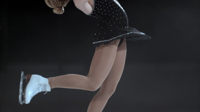 slo mo tu female figure skater in a layback spin - ice skating stock videos and b-roll footage