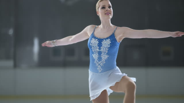 SLO MO TU Female figure skater in an upright spin