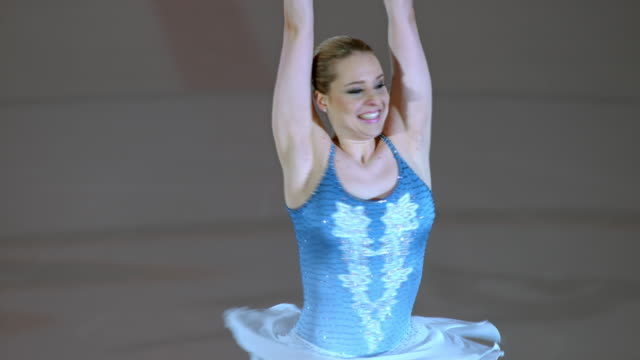 SLO MO LD Female figure skater performing an upright spin