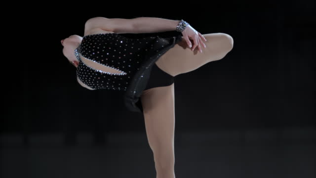 slo mo female figure skater performing elegant catchfoot layback spin - ice skating stock videos & royalty-free footage