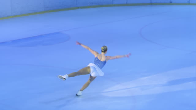 ts female figure skater performing her program - ice skating stock videos and b-roll footage