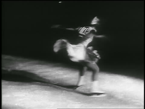 b/w 1935 female figure skater spinning then skating toward camera / canada - 1935 stock videos & royalty-free footage