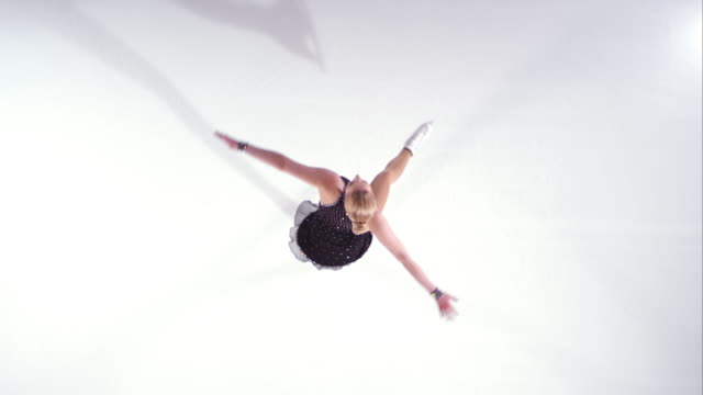 SLO MO CS Female figure skater spinning
