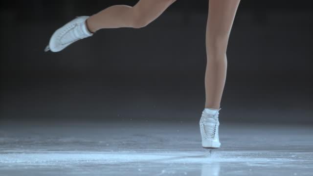 SLO MO Female figure skates in a spin