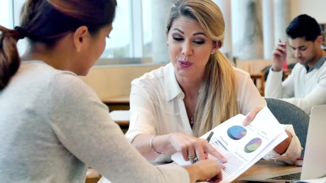Female financial advisor meets with female client