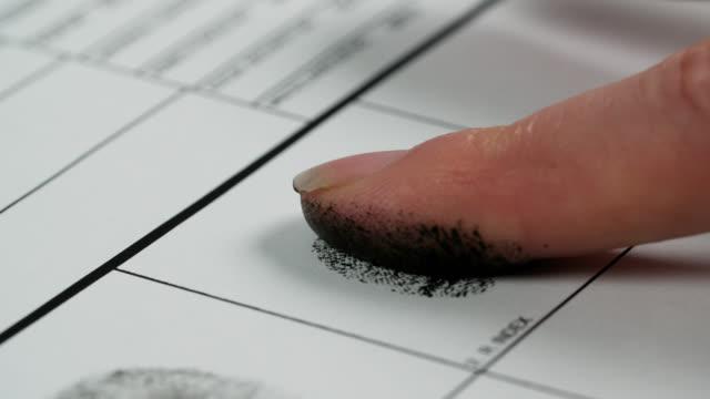 cu female fingerprint sample taken on chart - index finger stock videos & royalty-free footage