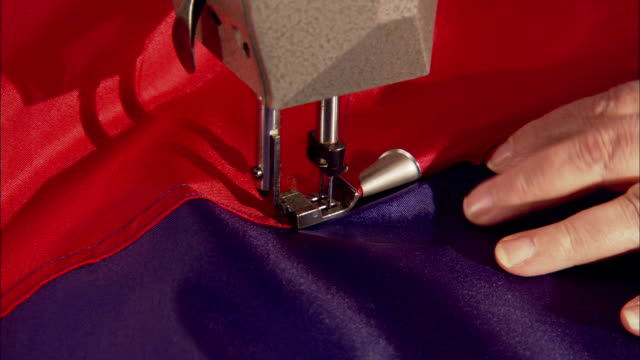 female fingers cutting thread from material w/ scissors. detailed work, fashion district, small business, hand-made, labor intensive, designer, not... - 裁縫点の映像素材/bロール