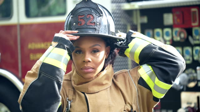 female firefighter in fire protection suit, helmet - firefighter stock videos & royalty-free footage